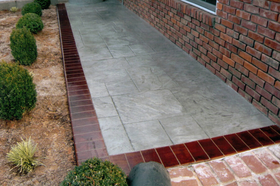 Stained Patterned Concrete with Brick Border