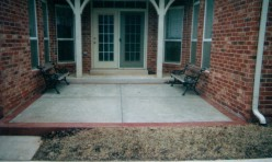 Textured Concrete Back Patio With Brick Border