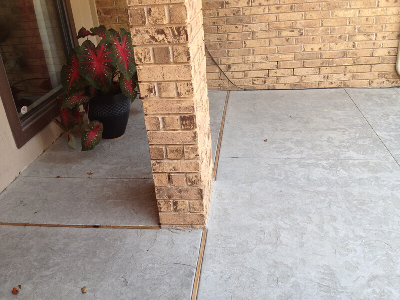 Textured Concrete Patio with Wood Expansion Joints